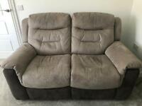 2 matching 2 seater reclining sofas.