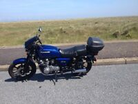Kawasaki GT750, LOW miles, top box and side panniers. great runner.