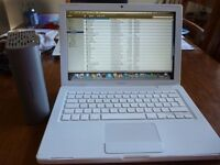 Macbook 3.1 with a My Book External HD, Spare Battery and Software Loaded