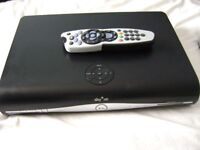 SKY HD BOX SLIMLINE WITH REMOTE IN GOOD WORKING ORDER.