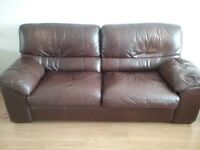 Leather settee in brown