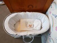Hardly used Moses basket with 5 bed sheets and duvet