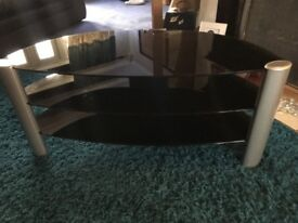 Black and silver glass TV unit