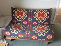 Double patterned futon/guest/pull out bed with wooden base
