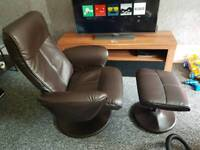 Brown leather swivel chair and foot stool