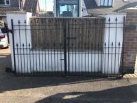 Pair wrought iron gates.