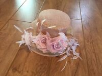 Ladies pretty pink hat with feather and flower detail from Accessorize