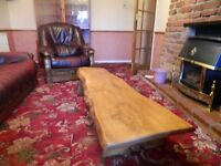 "Solid elm wood coffee table in antique pine stain - w 67"" d 21"" h 11"" selling as moving"