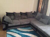 Corner sofa in grey/Black