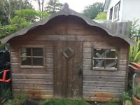 Wooden playhouse for sale. Excellent condition.