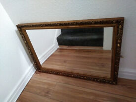 Mirror In Gold Coloured Wooden Frame
