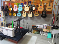 Job lot of 19 acoustic guitars, brand new, all with high-quality soft cases