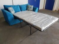 BRAND NEW BLUE FABRIC SOFA BED INCLUDING BRAND NEW MATTRESS AND CUSHIONS DELIVERY AVAILABLE