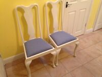 TWO WHITE PAINTED HIGHBACK REUPHOLSTERED CHAIRS