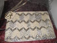 Clutch bag by Accessorize with original label showing £29.