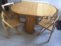 Dining table and chairs, space saver