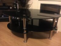 Black glass coffee table . Good condition