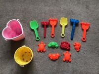 Selection of buckets, spades and beach toys