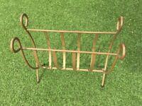 Sprung loaded magazine rack - small log holder