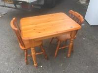 Nice little pine table and 2 chairs can deliver