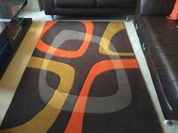 Arte Espina modern rug with a orange and mustard pattern