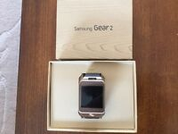 Samsung galaxy gear 2 smart watch, as new, gold with brown strap. Boxed with charger.