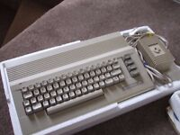 Boxed Commodore 64 with games/joystick