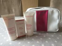 Clarins bag with body scrub, gentle facial peeling and moisture rich body lotion