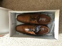 Two pairs of men's size 6 tan shoes