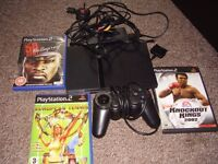PLAYSTATION 2 SLIM WITH ALL LEADS AND PAD AND GAMES