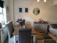 Nearly new Cottage dining suite extends to 8