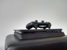 NEW 3 WEEKS OLD PS4 SLIM CONSOLE WITH WIRELESS CONTROLLER AND GTA V GAME