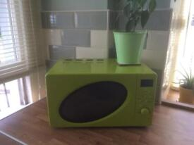 Microwave oven in lime green with accessories