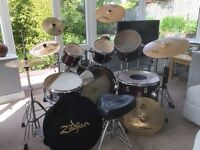 7 piece Stagg drum kit with set of 6 Zidljian ZXT cymbals. Double bass pedal. Well maintained kit.