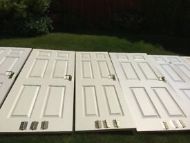 Internal semi-solid, white primed doors with good quality brass handle sets and brass hinges