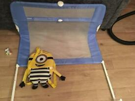 Blue bed rail and minion bag
