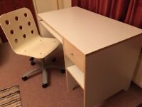 White IKEA desk and matching adjustable swivel chair.