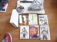 Wii Console + Fit Board + 5 Games & Controllers