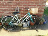 vintage ladies green and white universal 20 inch frame bike with basket and lock