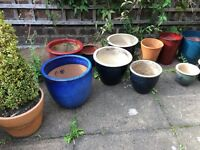 Selection of ceramic and terracotta garden plant pots from £7