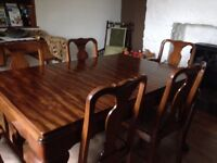 Mahogany dining table with nine chairs.