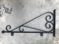 Wrought iron hanging sign bracket shop front