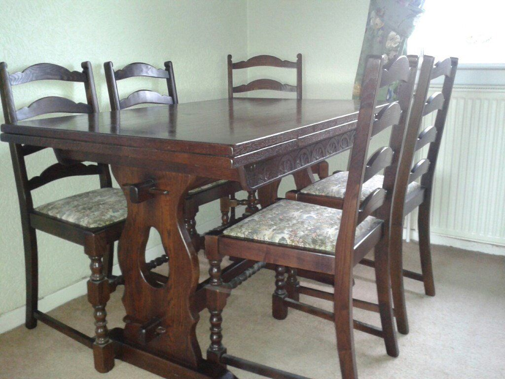 Dark Wood, Ercol Style, Extending Table 4 chairs and 2 carvers in very good condition