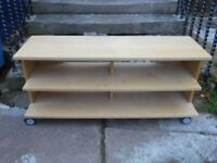Ikea pine coloured tv unit /bench on wheels