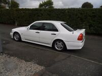 Mercedes C180. Genuine AMG bodykit and wheels, may swap