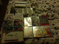 Nintendo wii with games, fitboard and accessories