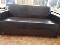 Free two seater leather brown sofa