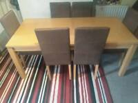 Light oak table and 6 leather dining chairs