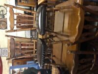 Extending oak table and six chairs