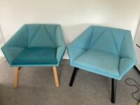 2 similar blue deep armchairs